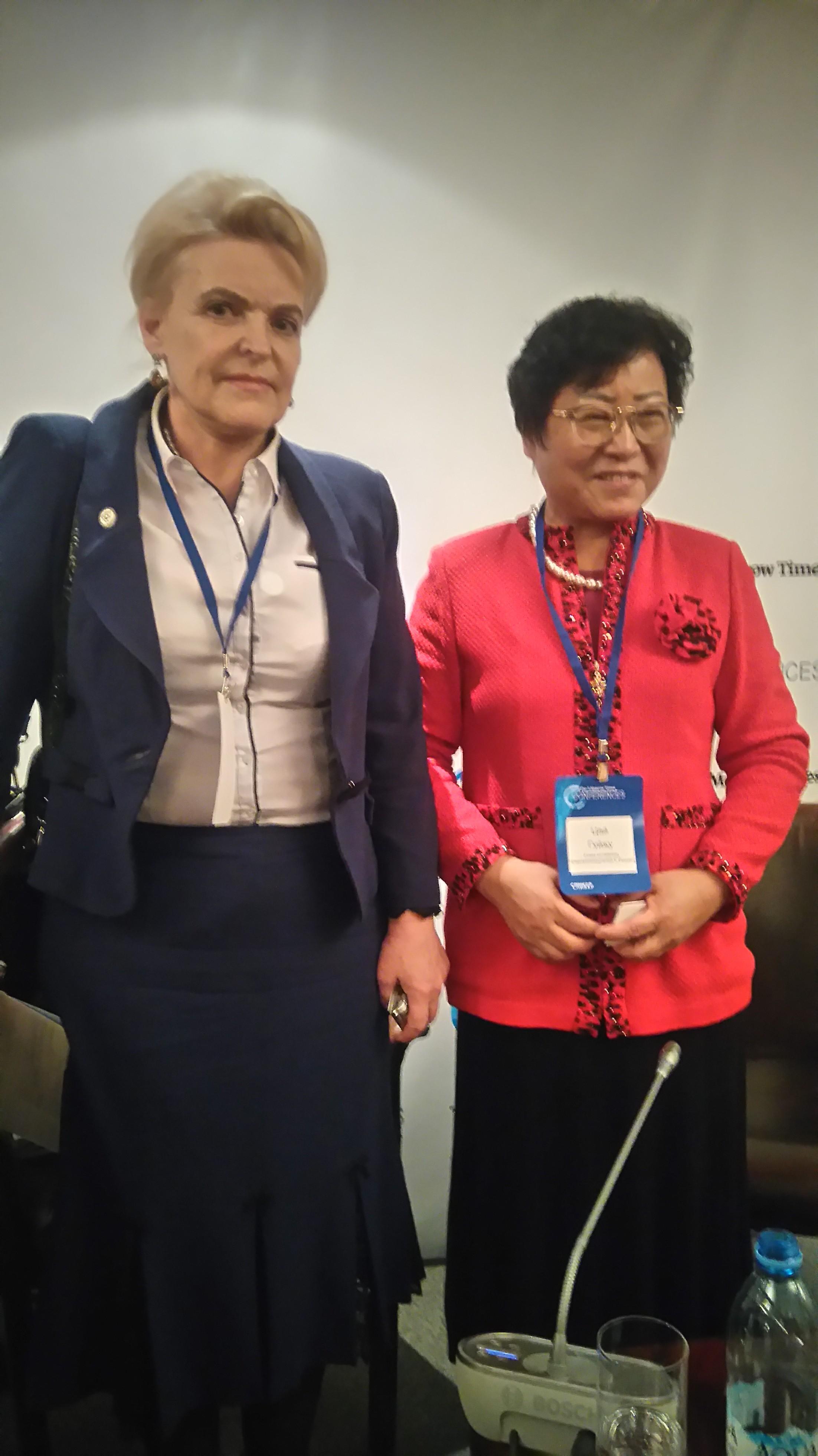 А.П. Оситис и Сюй Цзиньли
